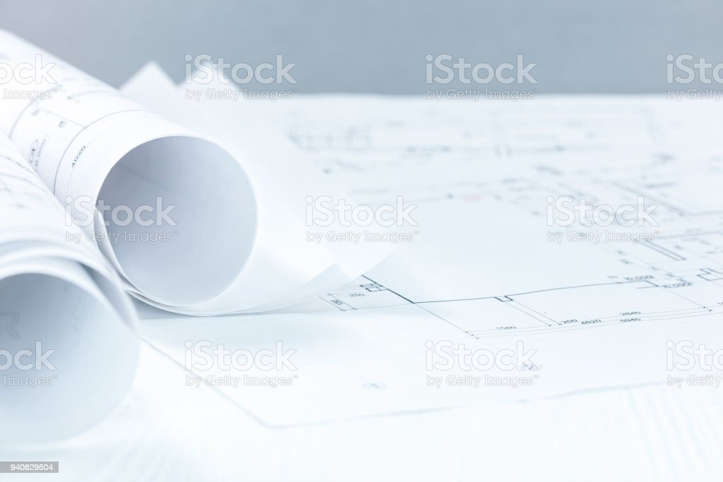 Architect blueprint rolls and drawing on desk with copy space stock architect blueprint rolls and drawing on desk with copy space royalty free stock photo malvernweather