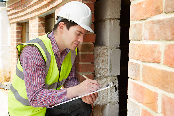 architect checking insulation during house construction - quality control stock photos and pictures