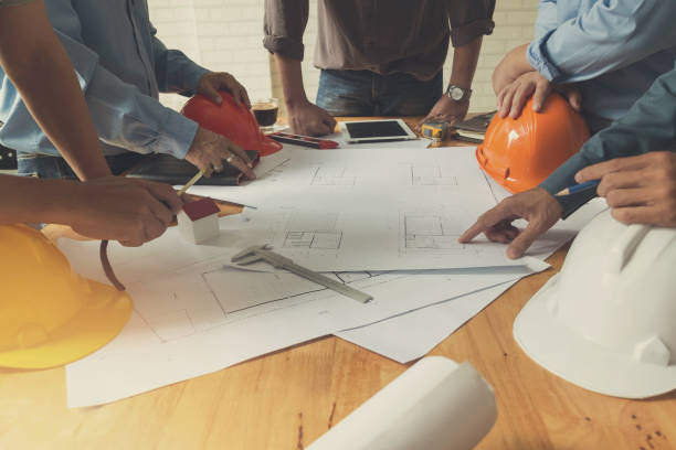 Architect concept, Architects team working with blueprints stock photo