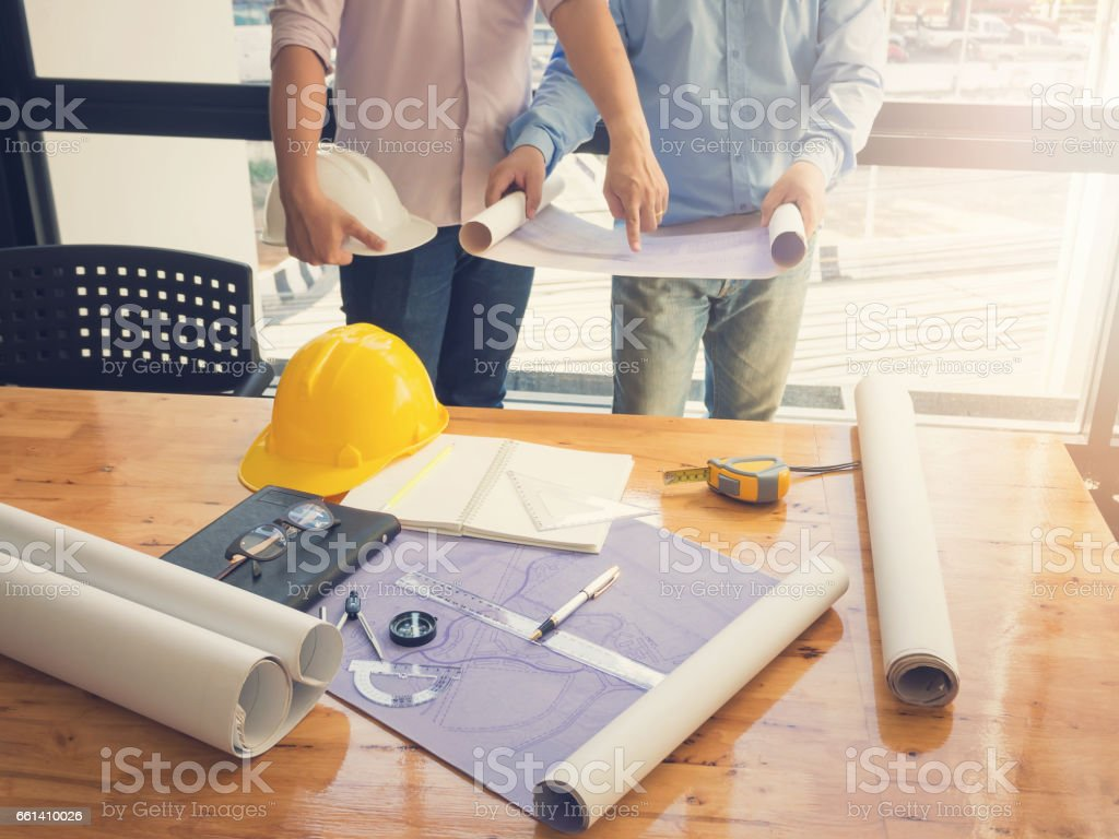 Architect concept, Architects working with blueprints in the office, Vintage Effect - foto stock