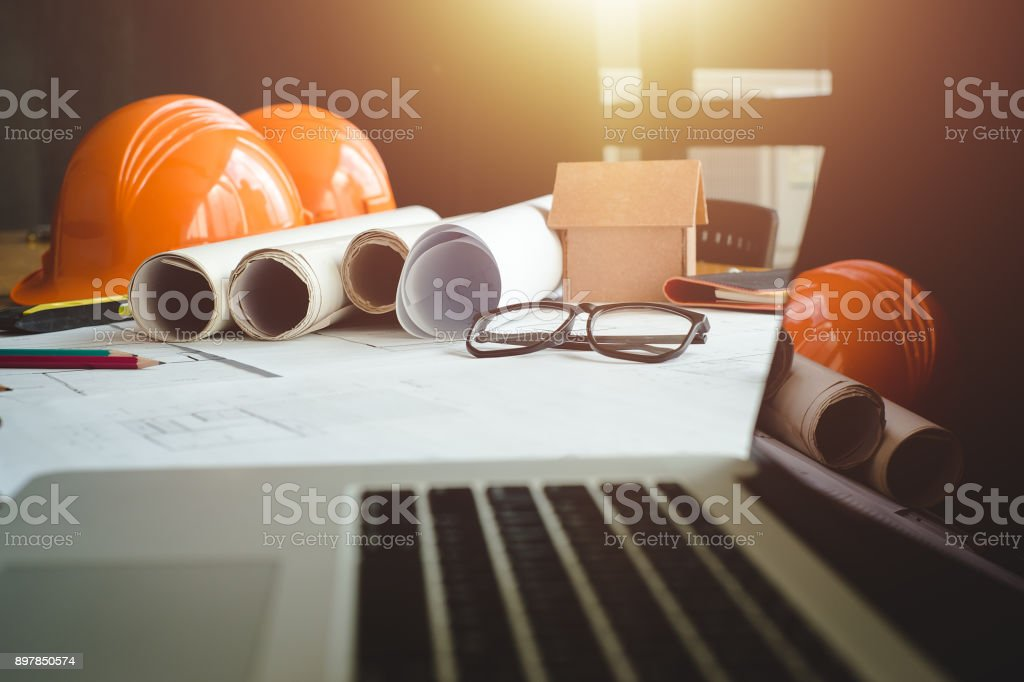 Architect concept. Business objects of architect on desk with engineer tools and architect analyzer working with blueprints and model house,Team meeting concept.Project ideas concept.Vintage effect,selective focus. Adult Stock Photo