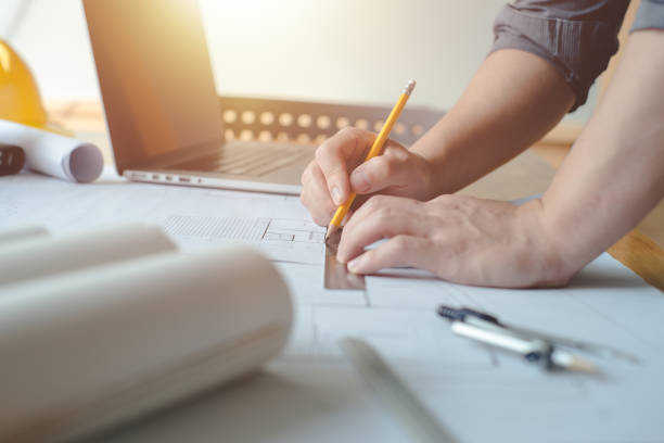 Architect concept. Hands of architect  or engineer using pencil working with blueprint on desk in office. Engineering tools and construction concept. Architect and Business concept.Teamwork Concept.Vintage effect. blotter stock pictures, royalty-free photos & images