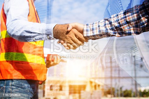 912867216istockphoto Architect contractor shaking hands with client at construction site 1167350804