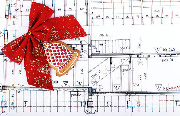 architect design blueprints and project drawings on table christmas background