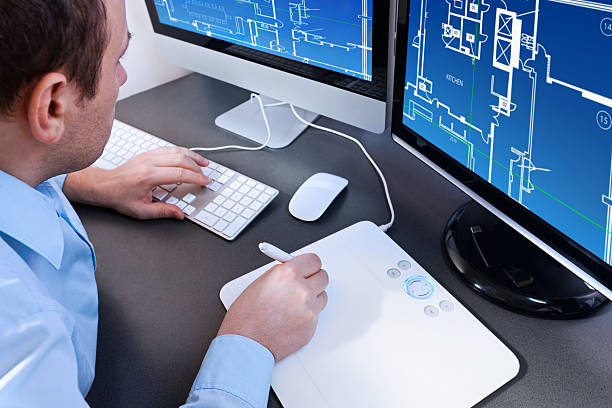 architect designer. architect working on a computer project home. - building graphic 個照片及圖片檔