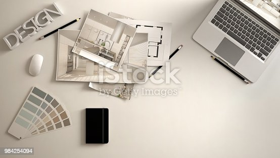 Architect designer concept, white work desk with computer, paper draft, kitchen project images and blueprint. Sample color material palette, creative background idea with copy space