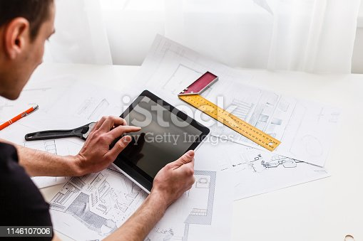 istock Architect designer Interior creative working hand drawing sketch plan blue print selection material color samples art tools Design Studio 1146107006