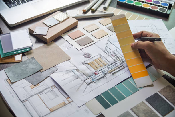 Architect designer Interior creative working hand drawing sketch plan blue print selection material color samples art tools Design Studio stock photo