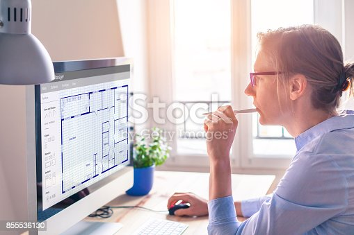 istock Architect designing blueprint floor plan sketch on computer, architecture 855536130