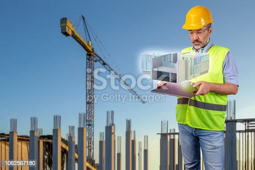 464482634istockphoto architect displaying a hologram of house model 1062567180