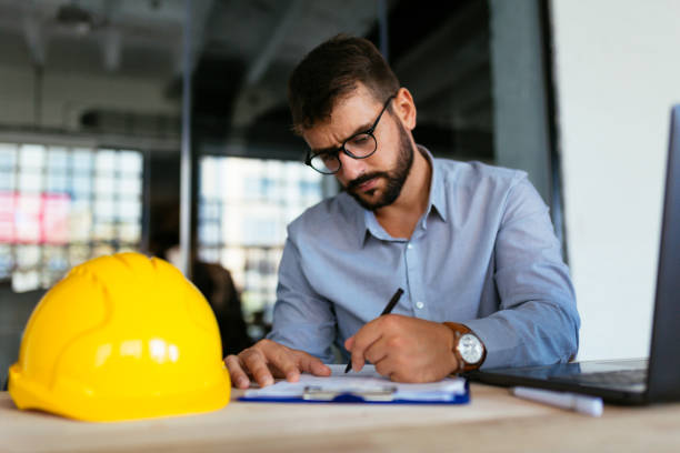 Architect doing some work at office stock photo