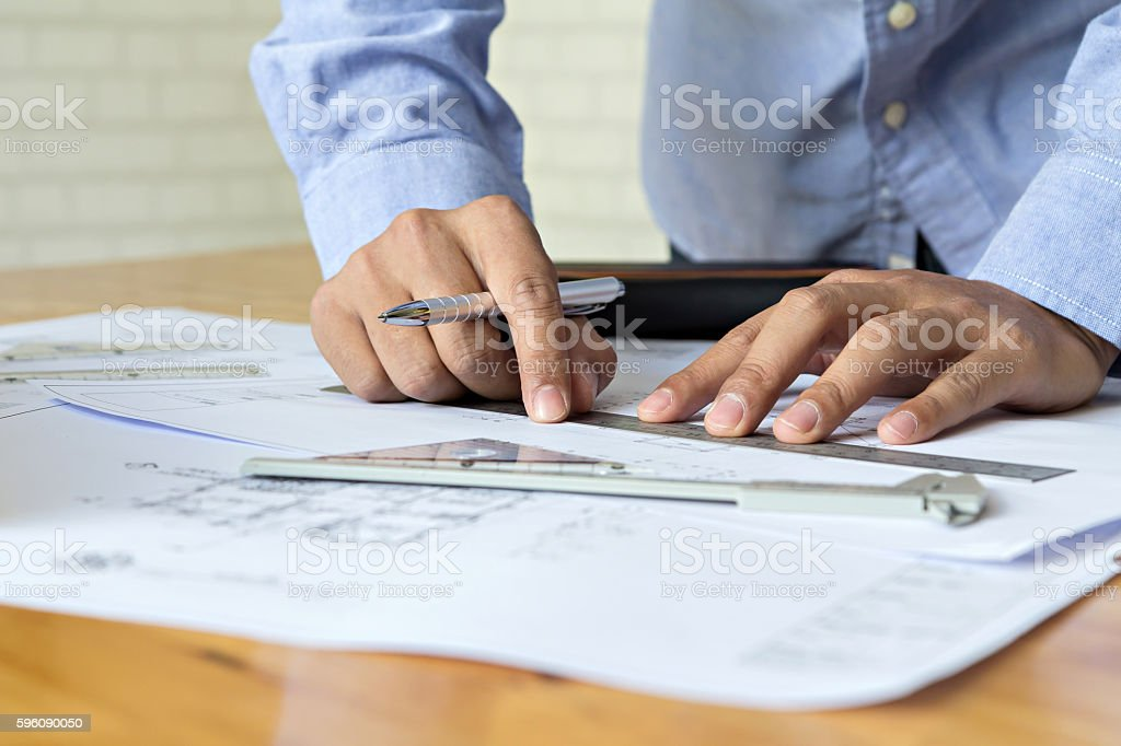 architect drawing on blueprint architectural concept stock photo