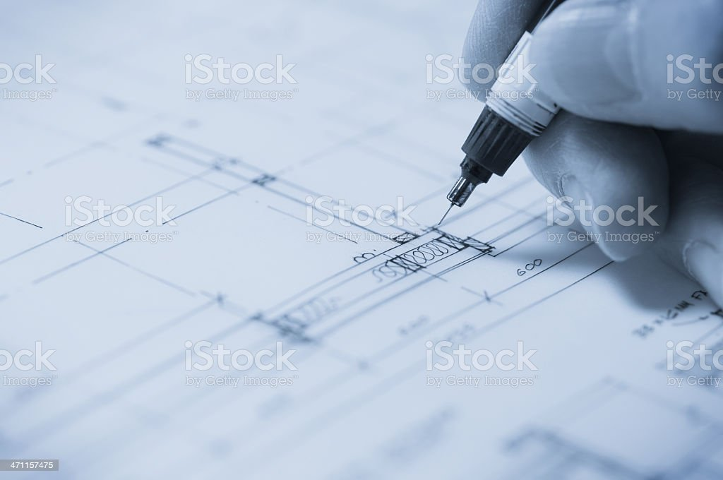Architect drawing plans royalty-free stock photo