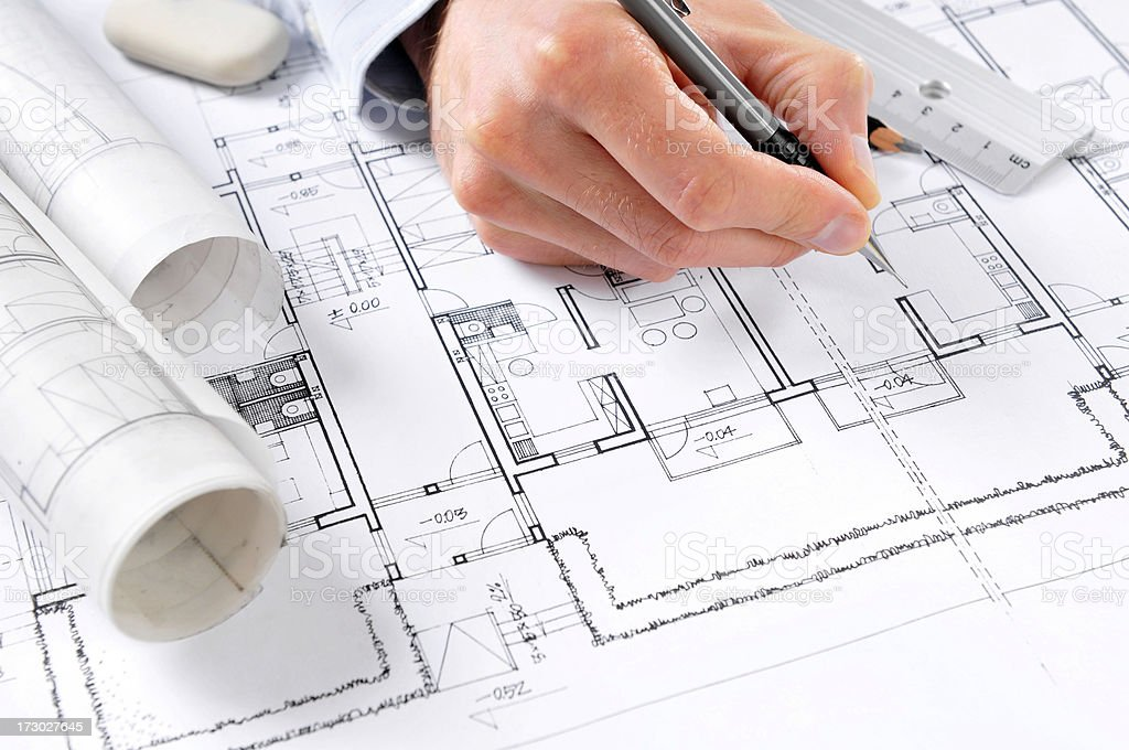 Architect draws plans - Royalty-free Adult Stock Photo