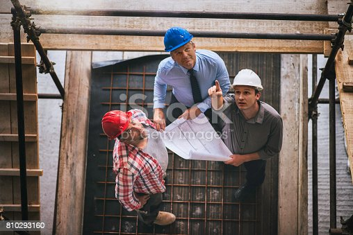 istock Architect, engeneer and foreman on a construction site 810293160