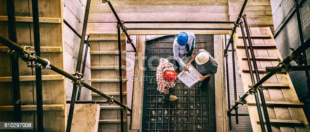 istock Architect, engeneer and foreman on a construction site 810297008