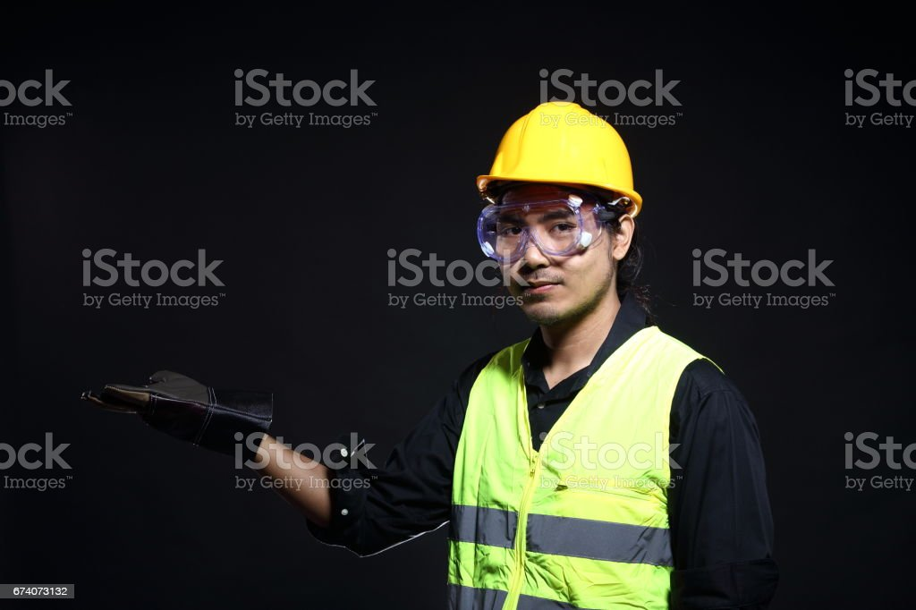 Architect Engineer in hard hat and safety equipment stock photo