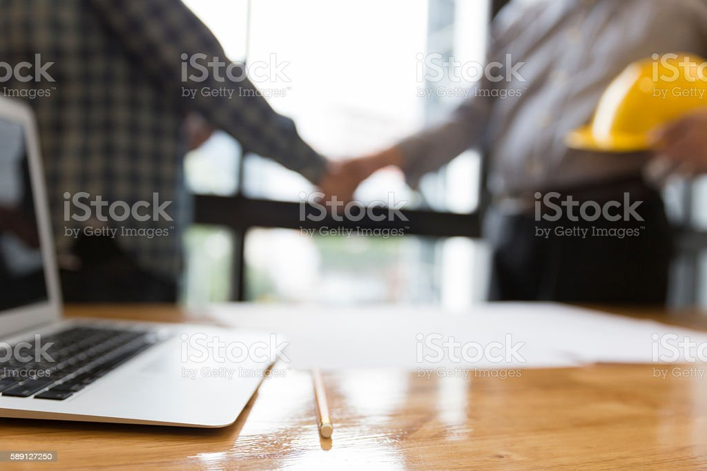 architect engineer shaking hands beside window - business – Foto