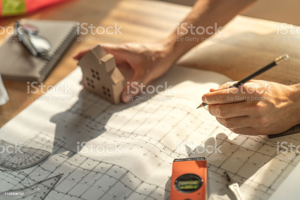Architect & Engineer working drawing document about project planning...