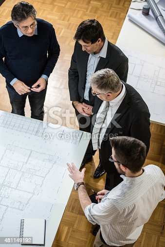 istock Architect explaining blueprint to client 481149192