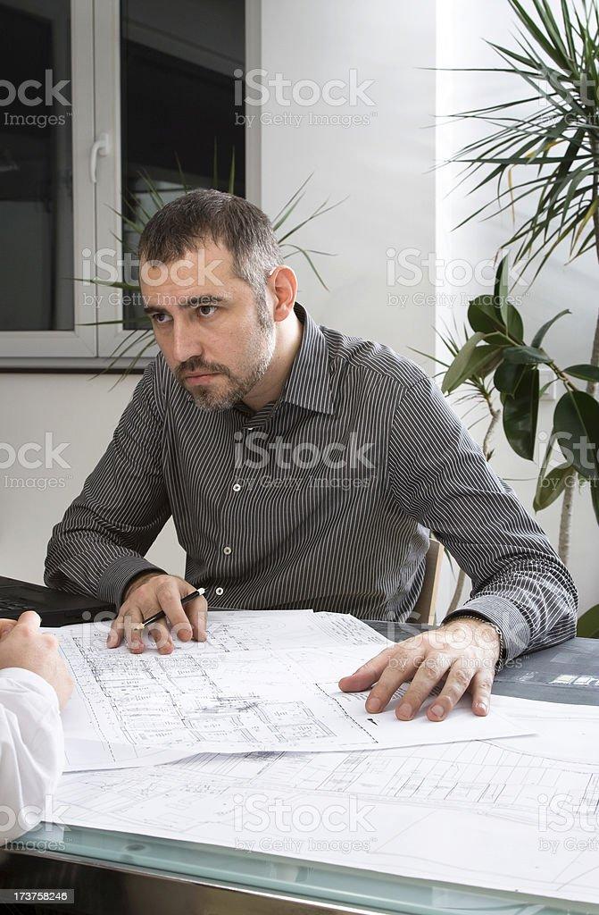 Architect explaining royalty-free stock photo
