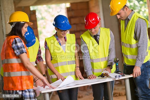 516607254 istock photo Architect explaining plan to group of workers 516604368