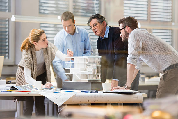 Architect explaining project plan to client stock photo