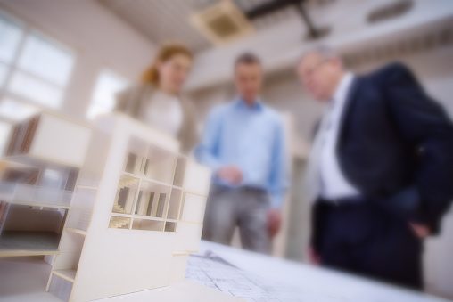 532257236 istock photo Architect explaining project plan to clients 481991902