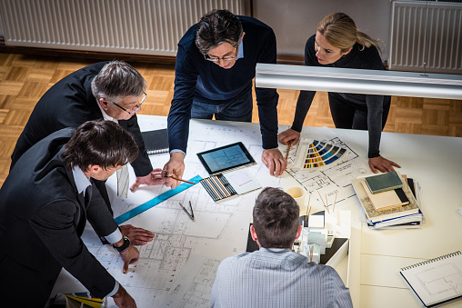 532257236 istock photo Architect explaining project plan to clients 482007476