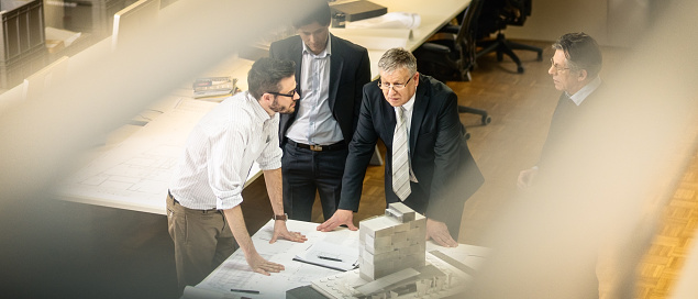 532257236 istock photo Architect explaining project plan to clients 482967894