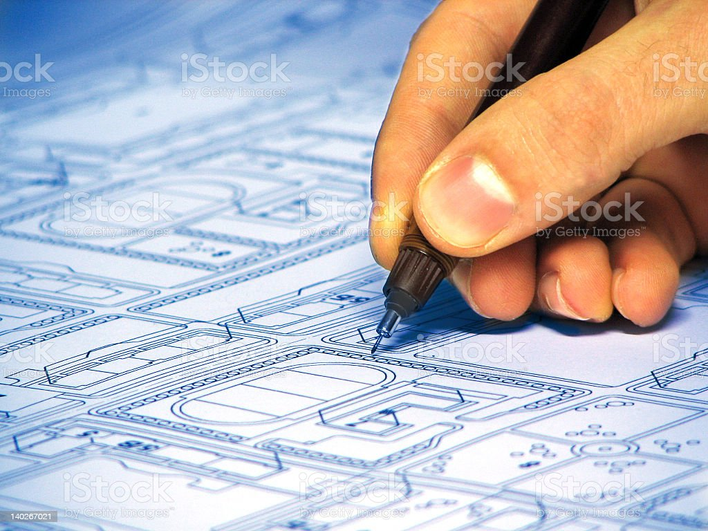 Architect finishing the finer detail of a blueprint royalty-free stock photo