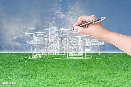 istock architect hand drawing a house 499234642