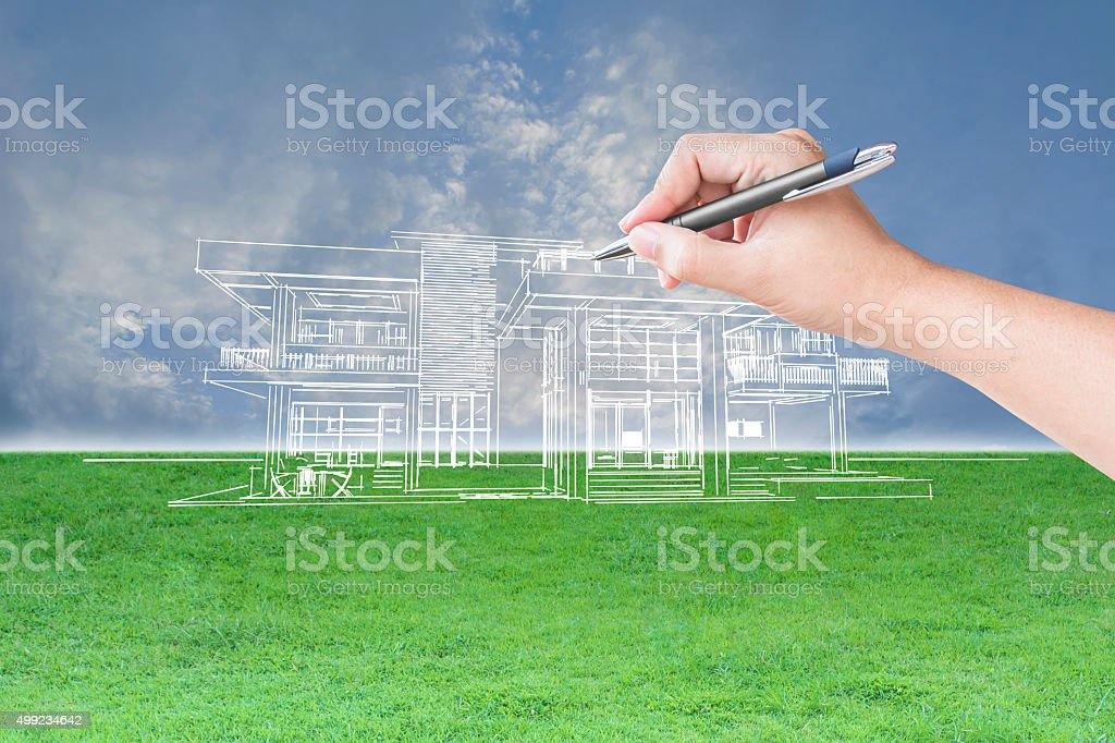 architect hand drawing a house stock photo
