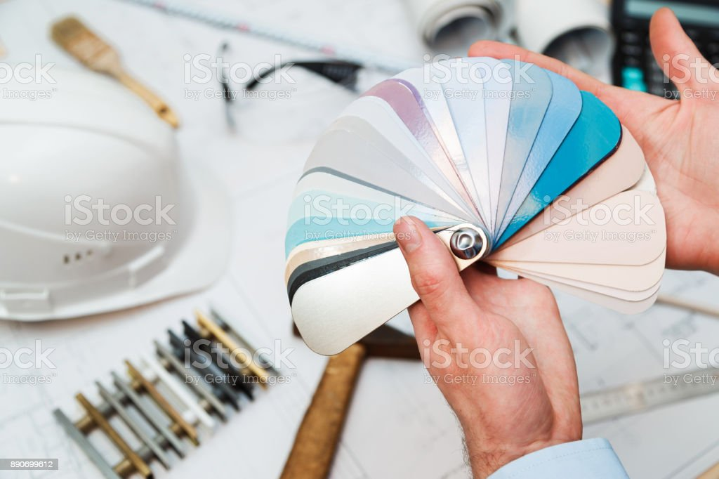 Architect hands with material sample, renovation concept. stock photo