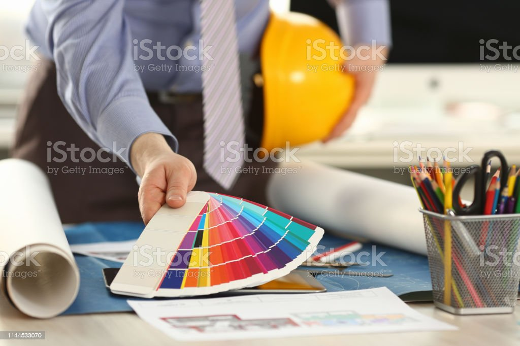 Architect Holding Spectrum Color Palette at Office. Male Employee...