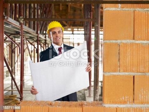 istock architect in construction site 153711866