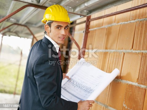 istock architect in construction site 153711894