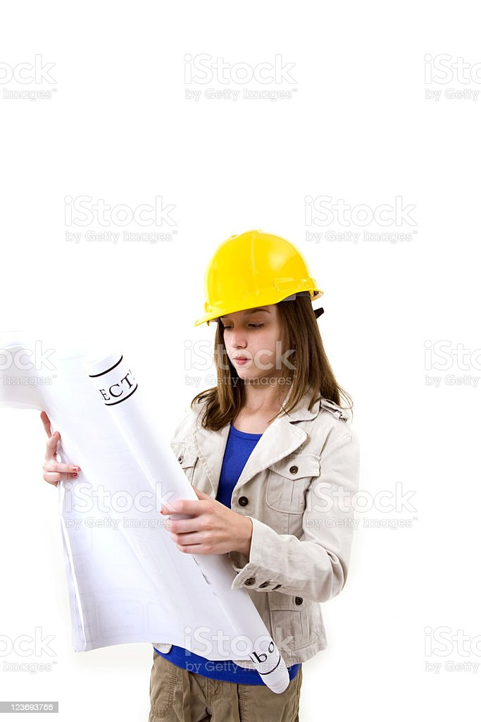 Architect in training  Young pre-teen studying blueprints. royalty-free stock photo
