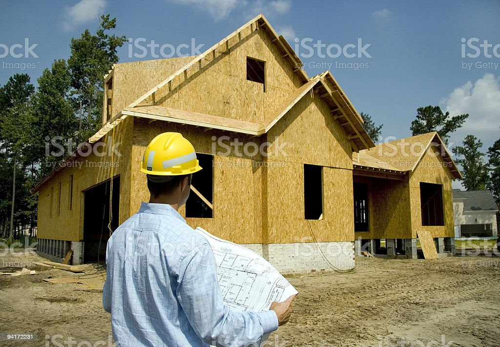 Architect Inspecting Construction Project royalty-free stock photo