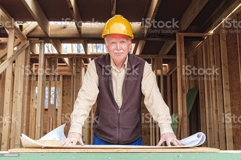 Architect, inspector, contractor working at construction site. royalty-free stock photo
