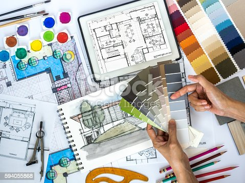 istock Architect, interior designer working at worktable with color swatch, sketch 594055868