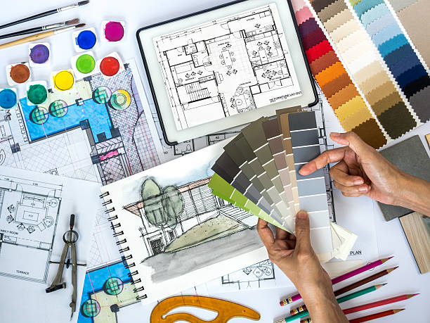 Architect, interior designer working at worktable with color swatch, sketch Top view of architect & interior designer working at worktable with  color swatch, tablet, sketch & blue print/ Real estate business & renovation conceptual interior designer stock pictures, royalty-free photos & images