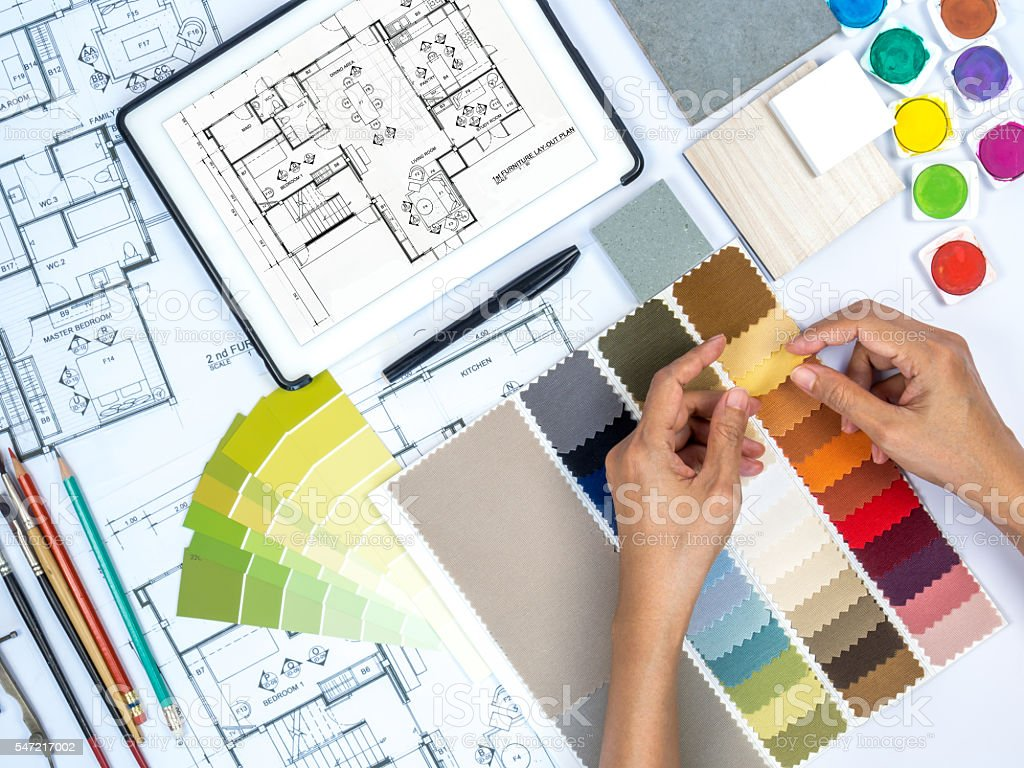 Architect interior designer working at worktable with fabric swatch tablet stock photo more for Best tablet for interior designers