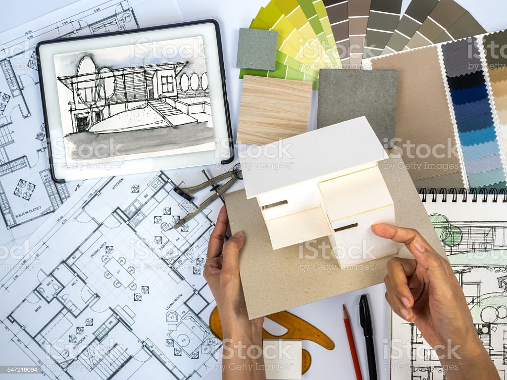 Architect, Interior Designer Working At Worktable With Home Model  Royalty Free Stock Photo