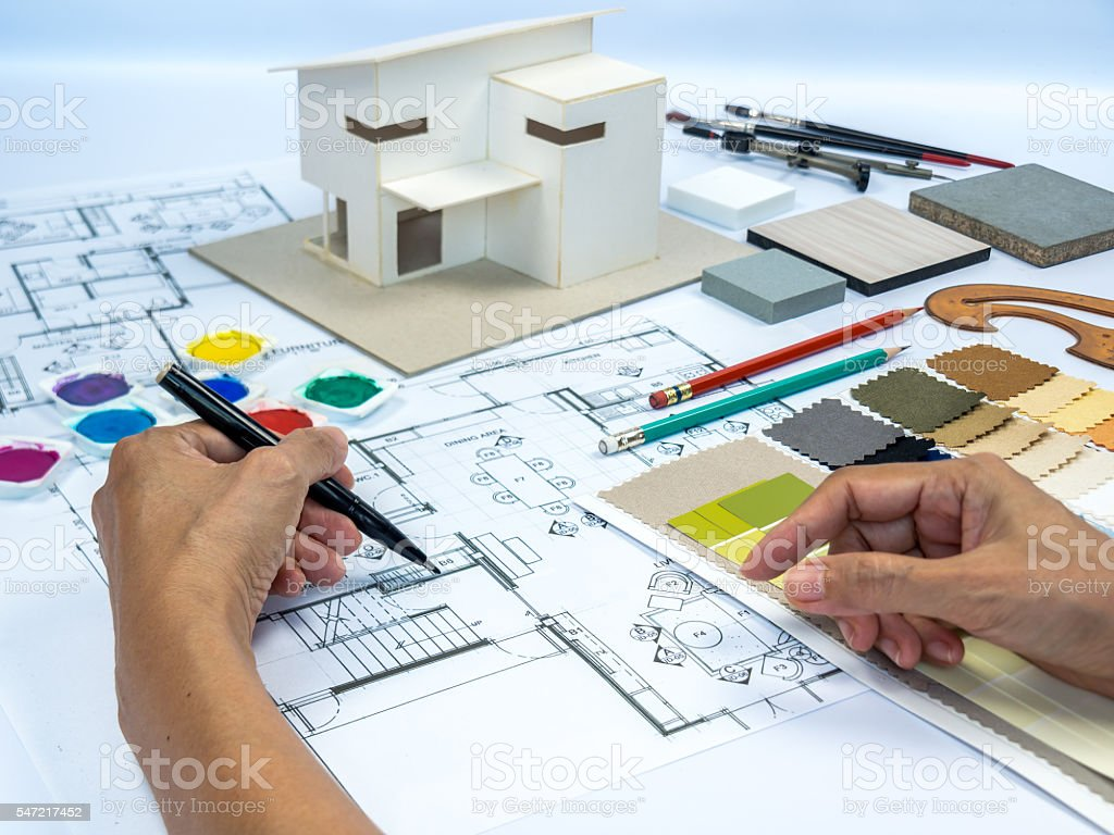 architect interior designer working at worktable with