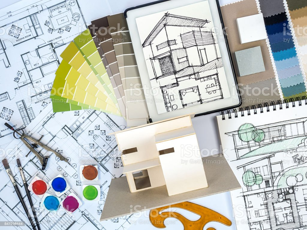 Architect interior designer worktable with home model sketch tablet stock photo more pictures for Best tablet for interior designers