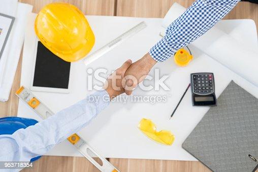 1071990712istockphoto Architect looing handshaking 953718354