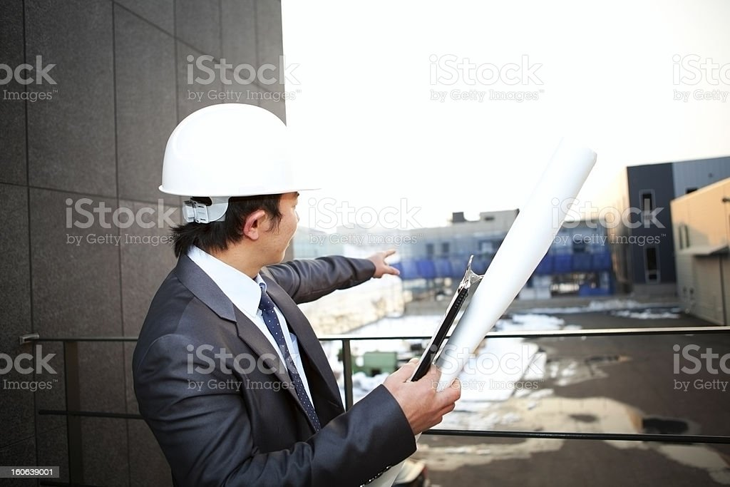 architect looking and pointing building construction stock photo