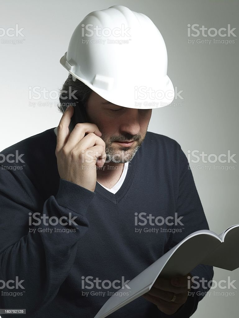 Architect looking at the project and speaks by phone royalty-free stock photo