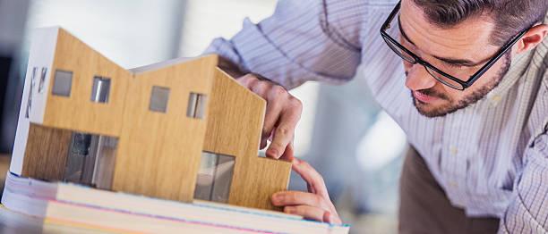 Architect making architectural model stock photo